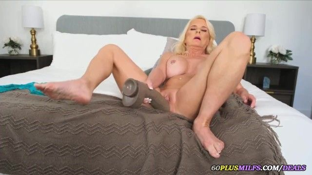 Breasty granny plays with biggest sex-toy